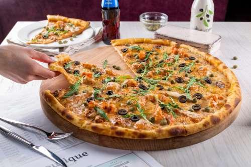 Hand Grabbling Pizza Slice