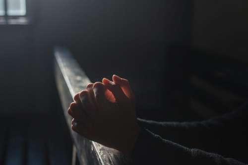 Hands Praying in Church