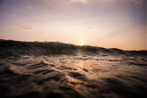 Breaking Wave at Sunset