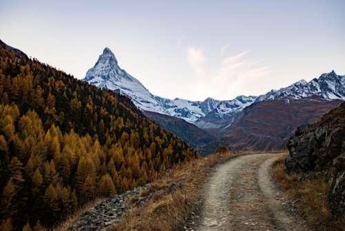 Mountain Path & Snowy Peaks