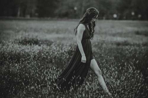 Woman Walking in Field
