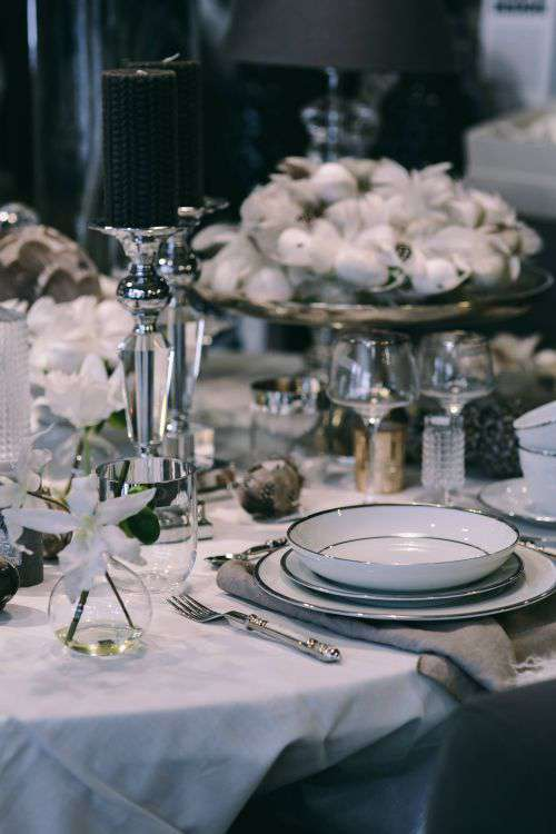Fancy restaurant dinner table decorated with quail eggs and feathers
