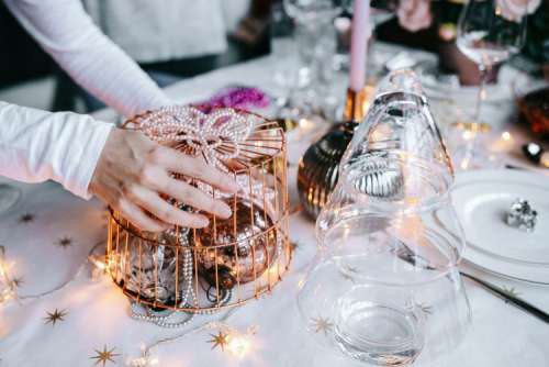 Hands Decorating Christmas Table