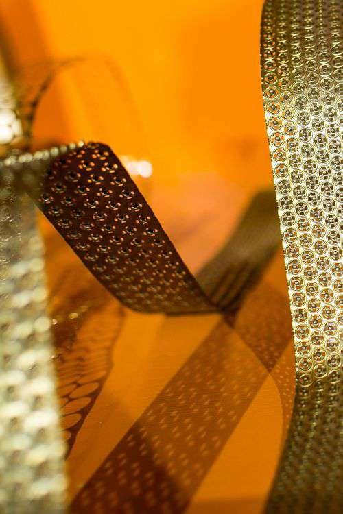 Bended golden metal on an orange background