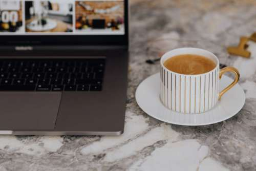 Coffee in a cup on a marble desk
