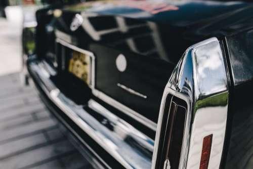 Close up of antique black and chrome Cadillac car