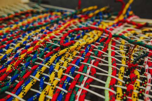 Colourful intertwined strings