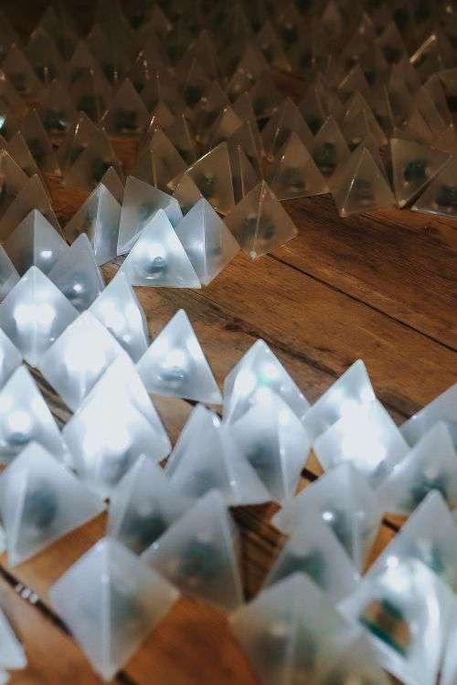 Little triangle lights on a wooden floor