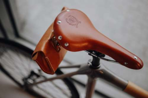 Brown leather saddle of bicycle