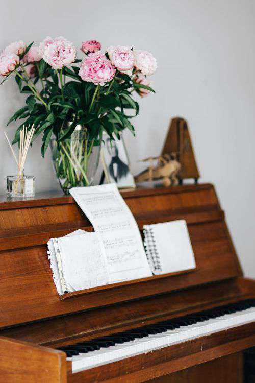 Old piano with sheet music