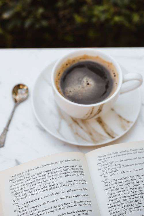 Cup of Coffee and an Open Book