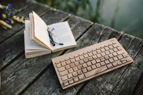 Male hand on the wooden keyboard