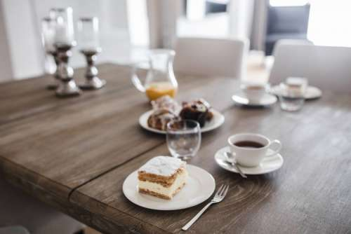 Sweet dessert with cream and a cup of coffee on a table