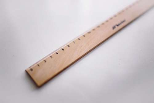 Bicycle paper clips and a wooden ruler