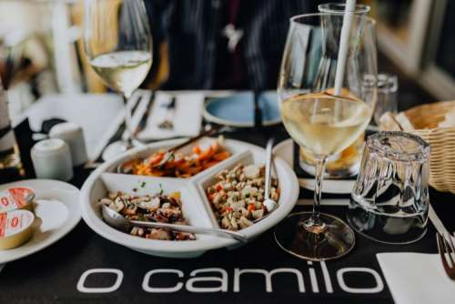 Dishes with various seafood at dinner table, O Camilo Restaurant, Portugal