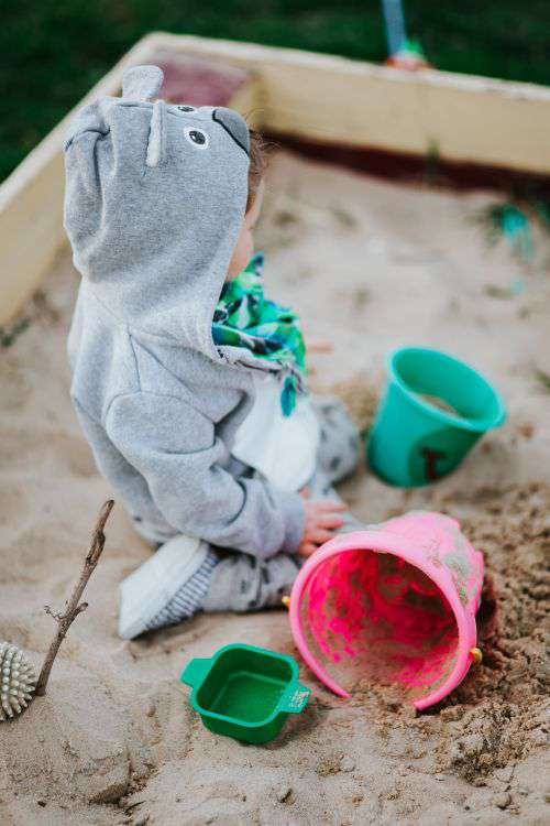 Toddler playing in the sand