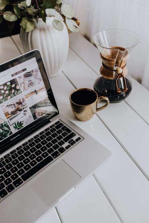Apple MacBook & Coffee on the white desk