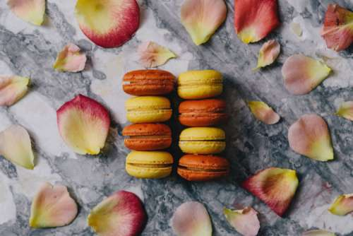 Overhead view of macarons on a marble slab