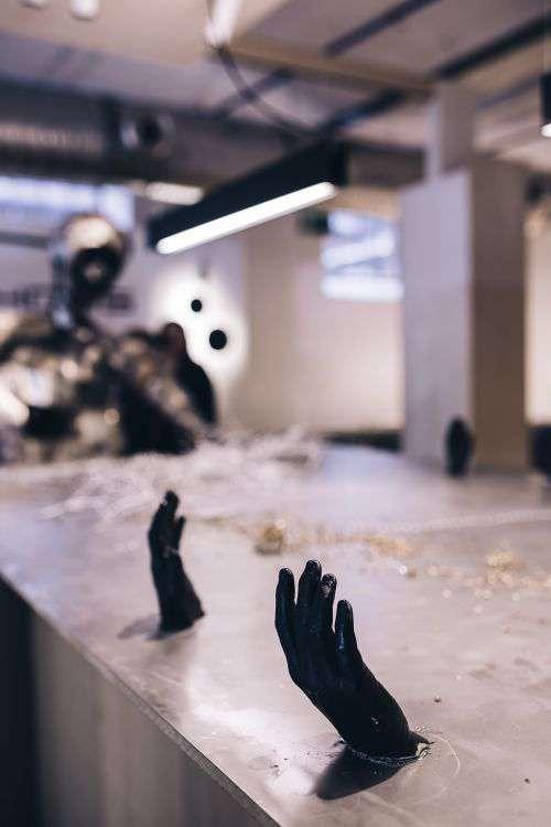 Metal figures by a table full of metal shavings