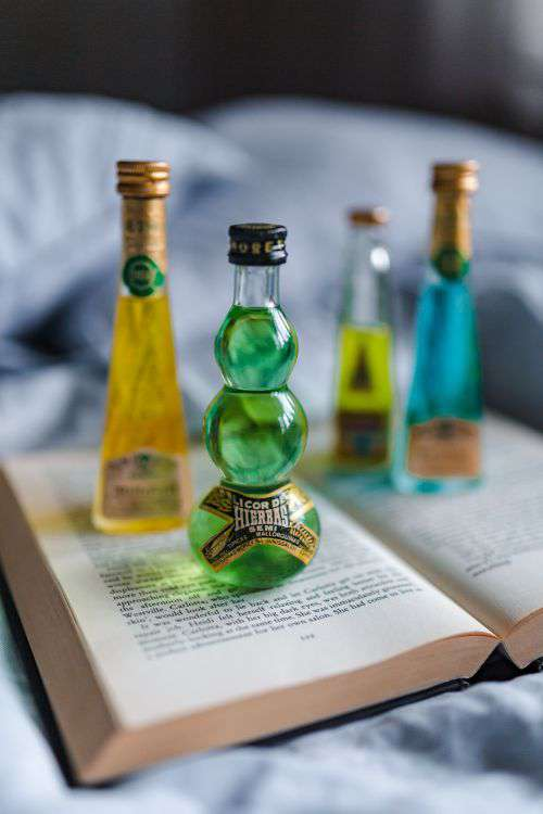 Group of colorful little bottles with liqueurs