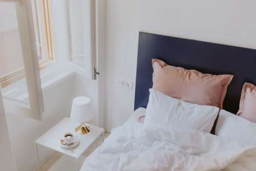 White bedroom interior with window