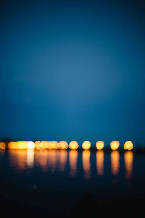 City lights reflected in the water at night