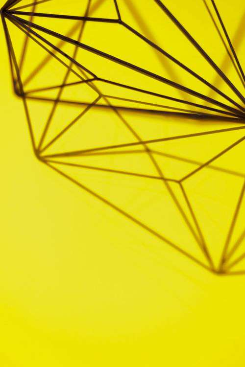 Geometric decoration on yellow background