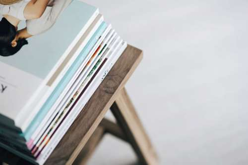 Stack of magazines on the wooden stool