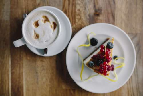 Cup of coffee and berry cheesecake
