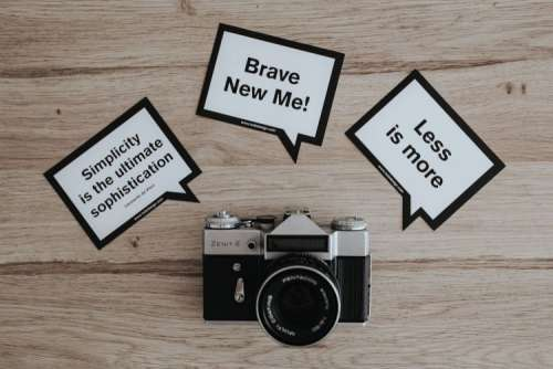 Little cards with inspirational quotes and a black camera