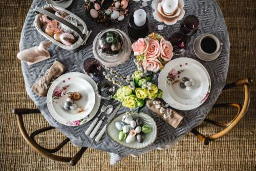 Round dinner table decorated with easter motifs