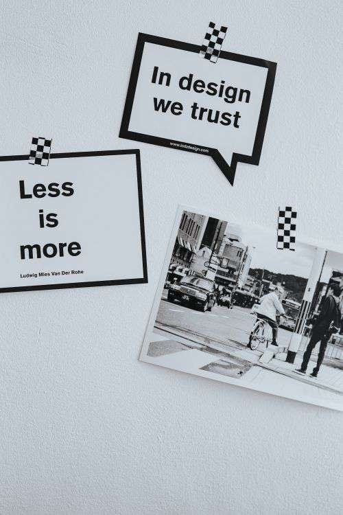 Inspirational cards with quotes, a black-and-white photo and a silver laptop