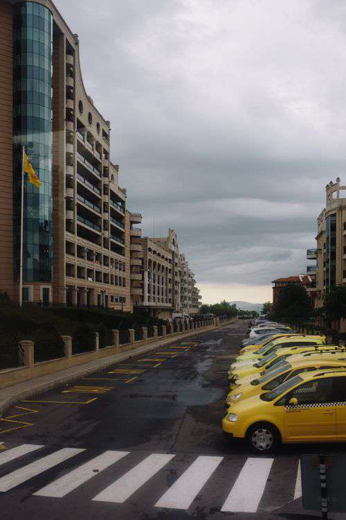Parked Yellow Taxi Cab Waiting for a Fare