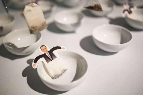 Funny tea bags and little white cups