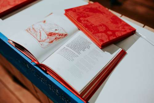 Red book on a white table