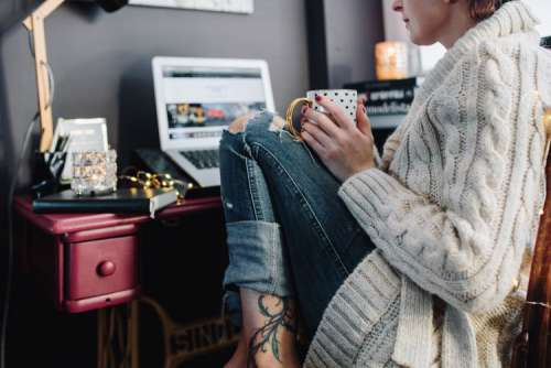 Woman drinking hot tea in her home office