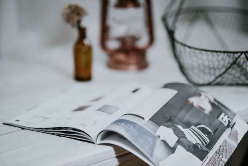 Magazine with a paraffin lamp on a white table