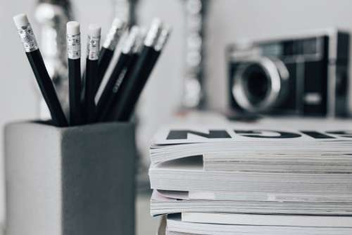 Pencils, magazines and an old lightbulb