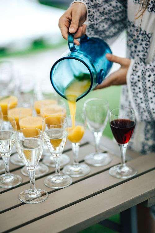 Glasses of orange juice, wine and water