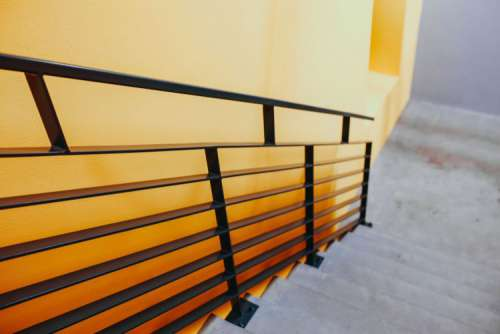 Staircase by a yellow wall