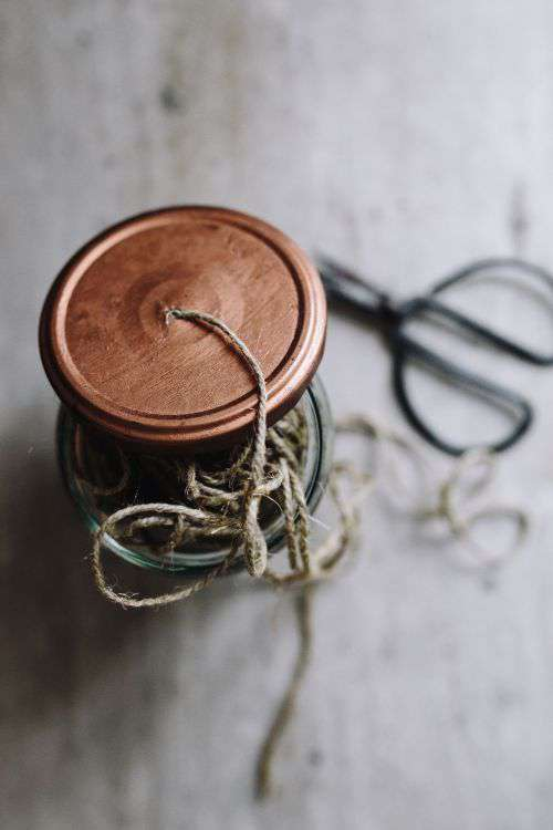 Thread in a jar and a paintbrush