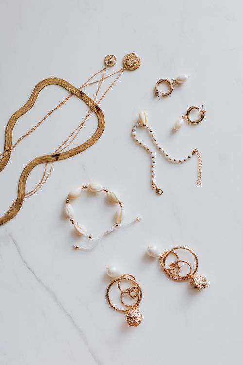 Gold jewelry on white marble