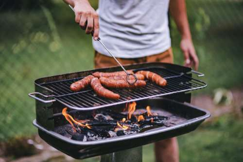 Pork and sausage on the grill