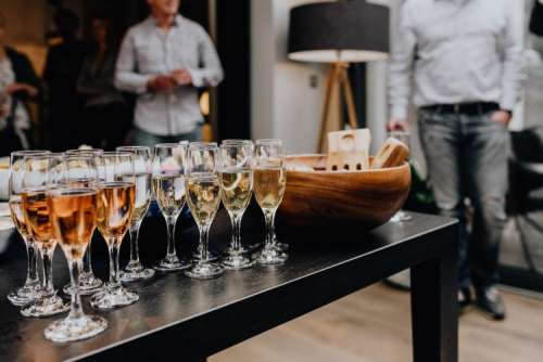 Glasses with white wine and champagne
