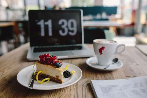 Working in a restaurant: Macbook, Cheese Cake and Cup of Coffee