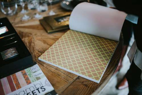 Golden photo frame and decorative paper on a table