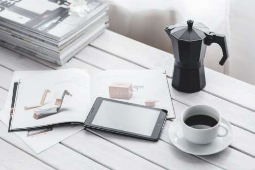 Coffee on a table with other items