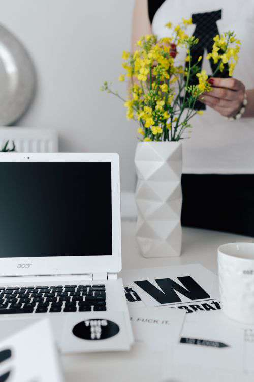 Workspace with yellow flowers