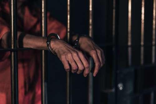 Handcuffed Prison Bars Free Photo