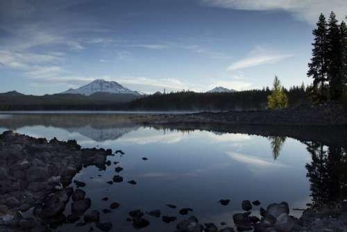 Snowy Mountains Over Lake Free Photo